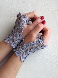 http://www.etsy.com/listing/173155775/tiny-flowered-fingerless-gloves-in-calm