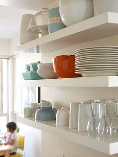 On the Shelf: floating shelves in kitchen/dining area provides easy access to dishes and stores larger items that my not fit easily in a cupboard.