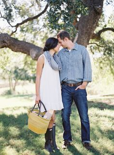 Picnic engagement ideas with Hunter Boots and a bowtie puppy