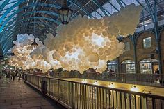 100,000 White Balloons Turn a London Shopping Center Into a Cloud | Mental Floss
