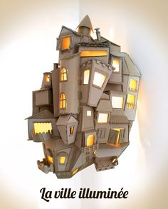 If you are artistic yourself, you don't need anything but cardboard, glue and lots pf imagination to craft this awesome village lamp. Cardboard City, Cardboard Sculpture, Cardboard Crafts, Paper Crafts, Cardboard Houses, Diy Luminaire, 3d Modelle, Creation Deco, Paper Houses