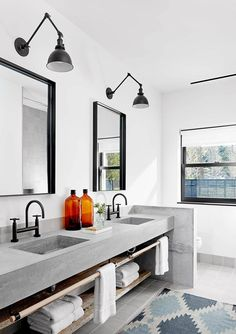 In this master bathroom, a custom-made concrete vanity with dual sinks has been included.