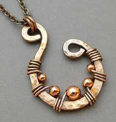 Copper Swirl Necklace.  Love the hammering on the wire.