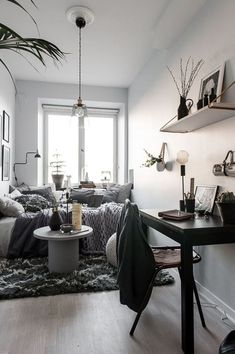 Modern grey Scandinavian bedroom in Göteborg, Sweden with a lush mix of textiles invites you to snuggle in.