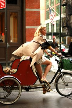Fashion designer Lela Rose rides her work tricycle on the streets of NYC.