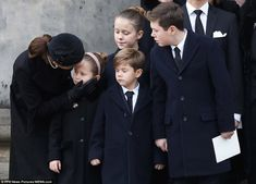 Princess Mary comforts one of her daughters as Henrik's grieving family stand outside the ...