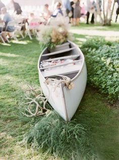 Canoe for holding drinks at lake reception - The Wedding Story of Hailey and Dustin Drost | WeddingDay Magazine