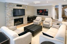 The fireplace with mounted television is a great feature for this modern styled living room. Bel Air Estates in Ancaster, Ontario. By Landmart Homes. #hamont #livingroomideas