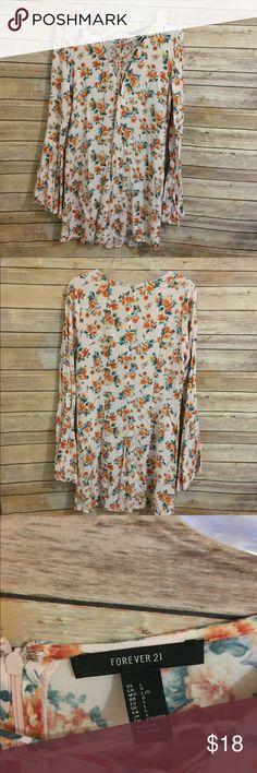 Forever 21 pink floral print dress Forever 21 pale pink floral print dress, lace up front, zipper back Forever 21 Dresses