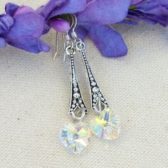 The super sparkling Swarovski crystal hearts are the real eye catchers of these beautiful handmade earrings, appropriately named SPARKLING HEARTS.  Created with faceted Swarovski crystals hearts that