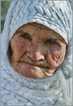 Pretty older ladies face with beautiful blue eyes.