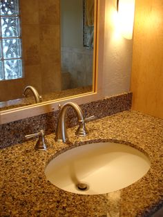 Counters: Cambria, color: Brownhill,   Integrated sink: Corian,  Faucet: Moen, Vestige
