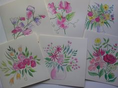Selection of hand painted floral cards.
