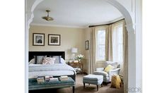 Actress Alexandra Wentworth turned to designer (and old friend) Elizabeth Martin to help her decorate the Washington, D.C., home she shares with Good Morning Americacohost George Stephanopoulos. In the master bedroom lively patterns on the armchair and bed pillows add a dose of energy to the room's subdued neutral palette. The curtain fabric is by Nancy Corzine and the armchair is upholstered in a linen by Raoul Textiles.