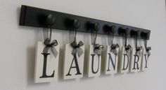 Laundry Room Wall Decor Personalized Hanging Letters includes Wooden 7 Hook Hangers and Letters LAUNDRY in Black