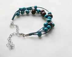 Teal bracelet made of waxed cord & wooden beads, $14.60