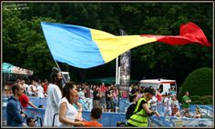 Not quite a tradition, but i can't help but appreciate a person wearing a traditional outfit and waving a Romanian flag :)