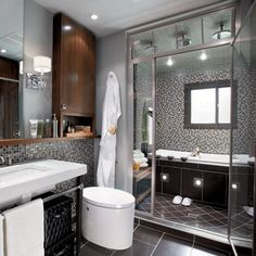 candice olsen bathroom with wet room, combination with shower in front and jacuzzi sunken tub in back