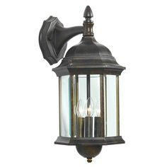 Metal lantern in golden bronze with a glass panel shade and finial top.     Product: Wall lantern   Construction Mater...
