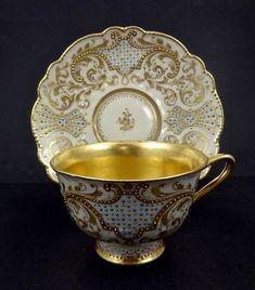Antique F. Hirsch Dresden Jeweled Tea Cup & Saucer, circa 1900. Lace like pattern in gold with turquoise dots.