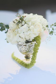 Floral centerpieces for Alex and Hunter's May wedding done by CD Florals. The Sonnet House | J. Woodbery Photography