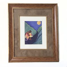 """Caribbean Girl by the Moonlight 85.00  This is a picture of a black girl in the Caribbean with her head down, holding her legs.  She is on the roadside and the light of the moon is casting its glow onto her.  It is double matted in a fruitwood frame with gold trim.  The outer mat is done in a speckled tan and the inner matting is white.  It also has a gold edge inside the frame.  It measures:  12.5"""" H x 11.5"""" W"""