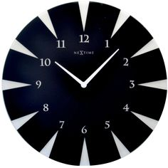 This NeXtime clock designed in frosted black glass will be a stunning feature in a contemporary living space.    8150 - Point.