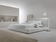 """A modern re-visitation of the classic Japanese bed. The space on the side means the bed can be used as a multi-functional """"island"""", a simple shelf or a counter."""