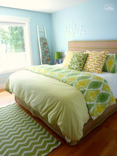 master bedroom for summer bed with mixed pattern bedding upholstered headboard at thehappyhousie