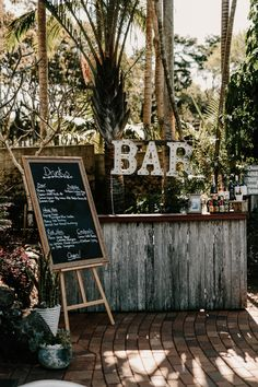 Rustic drink bar at this sophisticated outdoor wedding   Image by Zoe Morley