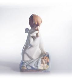 """01004635  ANGEL WITH BABY Issue Year: 1970  Retirement Year: 2003  Sculptor: Juan Huerta Size: 7x3½ """""""