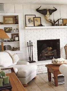 An all white room with gobs of textural interest (and it exudes coziness to-boot!)