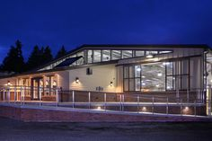 Arena and stable - by Equine Facility Design. Photo credit Martin Bydalek.