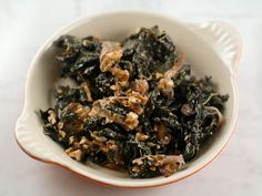 The Crisper Whisperer: Braised Kale with Caramelized Onions, Walnuts, and Blue Cheese | Serious Eats : Recipes  -  add quinoa to make it a meal