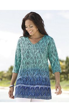 Cool turquoise and blue shades make a refreshing impression when higher temperatures roll in. Border design is defined with a horizontally striped band. V-neckline, 3/4 sleeves and side vents. <br />    <br />