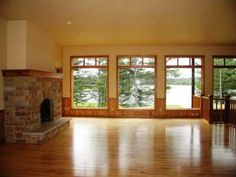 Spectacular living room with fireplace and lake view -- 5135 Torch Lake Rd, Conover, WI 54519