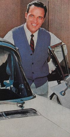 50s Fashion Men's Style | 1950s Mens Clothing Ad MENSWEAR Man In Blue Cardigan With Car