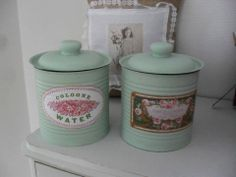 old large tin cans with saucepan lid, painted and with new tags