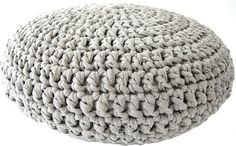 The pouf is made with t-shirt yarn, which you can buy here and you have to crochet this pouf with at least a needle size that's 10 mm thick, you can buy them here. You can use a thicker needle but ...