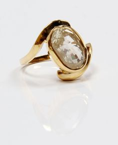 Pukhraj or yellow sapphire set in a stylish gold ring