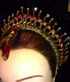 Stunning professional headpiece for the role of Raymonda and for other classical variations. Entirely hand crafted, it features a gold frame, gold, white and deep red crystals, and a central deep red