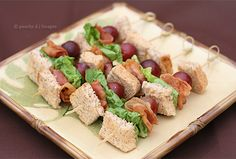 Bacon, lettuce and grape sandwiches on a stick.