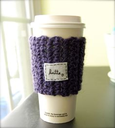This is a listing for a paper or reusable take out cup cozy that can have personalized wording added to it. These cozies are the perfect way to decorate an