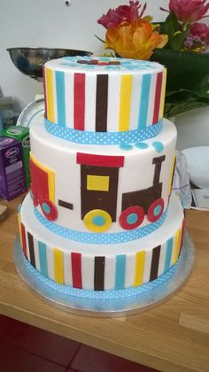 3 tier baptism cake with stripes and trains
