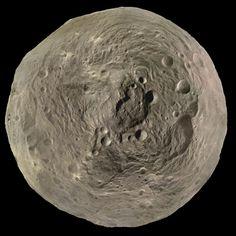 """The Best'a Vesta: Orbital Imagery Captures Asteroid's Towering Peak"" - ScientificAmerican.com, December 12, 2012. The peak in the crater Rheasilvia rivals Mars' Olympus Mons"