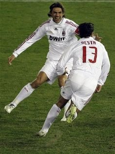 AC Milan's defender Alessandro Nesta, foreground, celebrates with his teammate Paolo Maldini after scoring the team's second goal during the second half of their final match against Boca Juniors at the FIFA Club World Cup soccer championship in Yokohama, near Tokyo, Sunday, Dec. 16, 2007. AC Milan won the final 4-2. (AP Photo/Shuji Kajiyama)