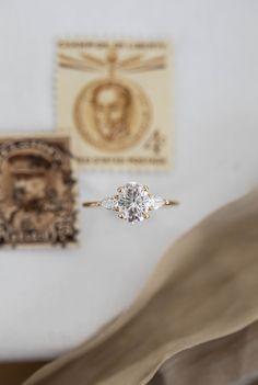 Rosemary | 8x6mm Yellow Gold | #threestone #oval #classic Pear Shaped Diamond, Oval Diamond, Diamond Rings, Olive Avenue Jewelry, Dream Engagement Rings, Moissanite Rings, Jewelry Companies, Wedding Sets