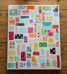 No-Sew Quilt Wall Art, cute way to display old baby clothes. I personally would use a collage frame with larger fabric squares.