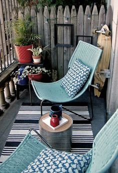 Cozy deck idea for my small deck.  Need more comfy chairs, but I like the rug.