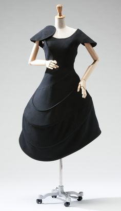 Black wool flannel one-piece dress, with four hoops in skirt designed by Yohji Yamamoto for F/W 1990